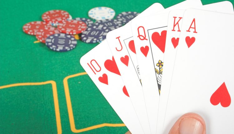 casino chips and cards showing a royal flush